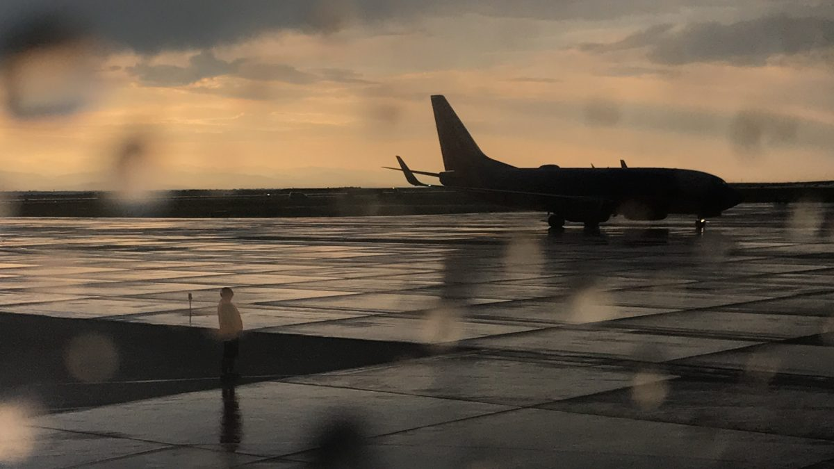 Plane in the Rainy Sunset